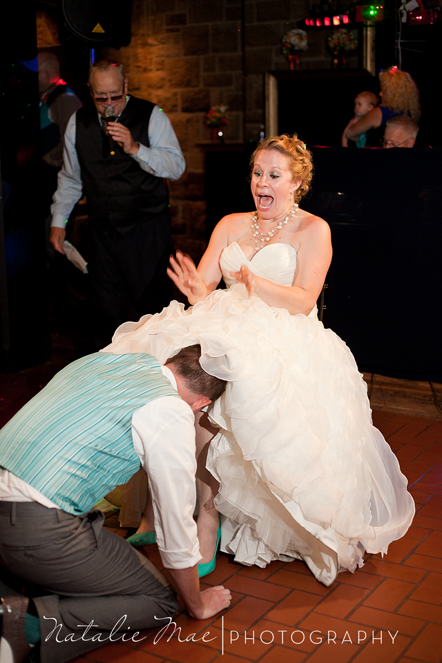 Katie's face is priceless as Doug goes in for the garter.