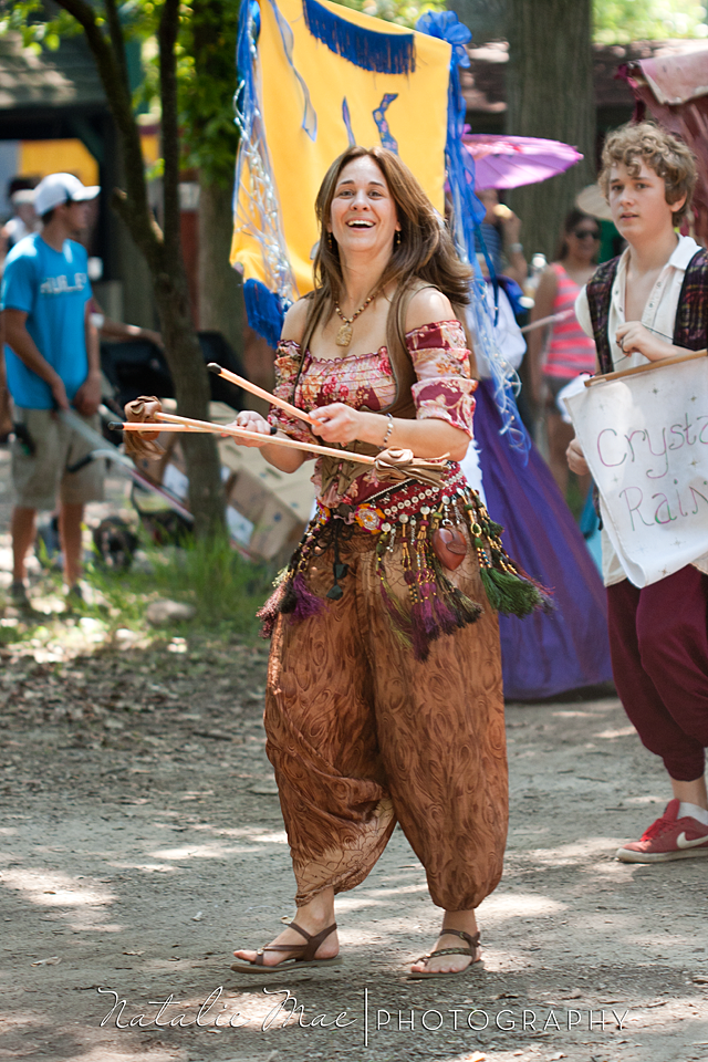"A talented ""wench"" juggles sticks while taking part in the parade."