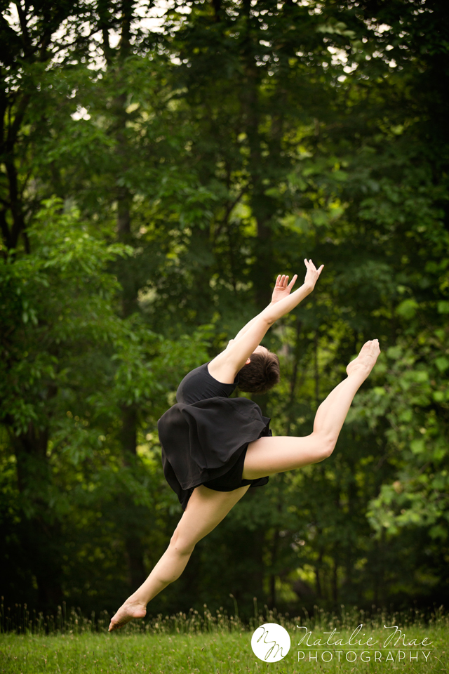 Leaping through the open field, Ann Arbor dance photographer timed this image perfectly.