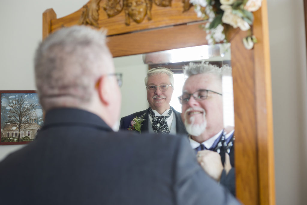 Michigan grooms in the mirror